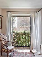 French windows from the ensuite bathroom overlook the village's 12th century Romanesque church