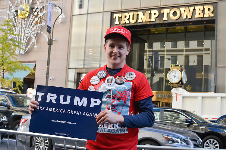 Gabe White of Utica, New York shows support for President Donald Trump.