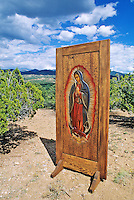 Woodcarver Kirk Kirkpatrick carved and stained a wooden door to produce this image of the Virgin of Guadalupe in Santa Fe, New Mexico