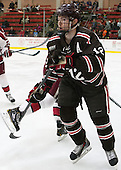 Mark Hourihan (Brown - 12) - The visiting Brown University Bears defeated the Harvard University Crimson 2-0 on Saturday, February 22, 2014 at the Bright-Landry Hockey Center in Cambridge, Massachusetts.