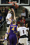 Louisville's Montrezi Harrell (24) is fouled going to the basket by  Northern Iowa State's Seth Tuttle (10)  during the 2015 NCAA Division I Men's Basketball Championship's March 22, 2015 at the Key Arena in Seattle, Washington.  Louisville beat Northern Iowa State 66-53 to advance to the Sweet 16.   ©2015. Jim Bryant Photo. ALL RIGHTS RESERVED.