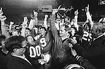 FTB 611 DD 43A Holiday MO..Football Holiday Bowl. Coach LaVell Edwards with trophy. 00. 9 Rob Ledenko. 25 Bobby Salazar. KSL News Radio...Dec 23, 1983..Box Number: 6371..Photo by: Mark Philbrick/BYU..Copyright BYU PHOTO 2008.All Rights Reserved.801-422-7322.photo@byu.edu