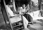 Highland Park PA:  Alice Brady Stewart and Helen Stewart reading on Brady Stewart's front porch on Wellesley Avenue - 1916