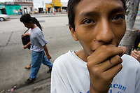 Jorge, 15, huffs solvent from a soaked ball of cloth. Guatemala's street kids mainly use paint thinner instead of glue, as it is cheaper and gives them a sense of relief from hunger pains and cold nights. A small bottle of paint thinner costs less than a dollar.