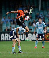 Brisbane Roar Thomas Broich (top) and Sydney FC Sasa Ognenovski during their A-League match in Sydney, March 14, 2014. Photo by Daniel Munoz/VIEWPRESS EDITORIAL USE ONLY
