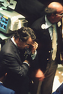 Fustrated Stock Brokers inside of the New York Stock Exchange on Wall Street dealing with the aftermath of Black Monday, when stock markets around the world crashed.