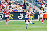 Alex Morgan (13) of the United States (USA) shoots and scores during the first half against China (CHN) during an international friendly at PPL Park in Chester, PA, on May 27, 2012.