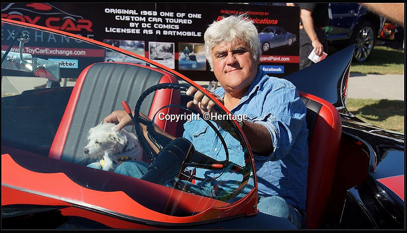 BNPS.co.uk (01202 558833)<br /> Pic: Heritage/BNPS<br /> <br /> ***Plase Use Full Byline***<br /> <br /> American TV show host, Jay Leno in the Batmobile. <br /> <br /> The world's first Batmobile has emerged for sale for a whopping &pound;300,000 after being rescued from a field where it spent almost 50 years languishing.<br /> <br /> Batman's famous car was built more than 50 years ago from a 1956 Oldsmobile 88 that was converted to look just like the one from the comic books which made the Caped Crusader famous.<br /> <br /> It is a far cry from the Batmobile that appeared in Christopher Nolan's modern remakes of Batman.<br /> <br /> But as the first Batmobile ever built, experts at Dallas-based Heritage Auctions say it could sell for as much as $500,000 - more than &pound;300,000.