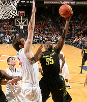 Dec. 17, 2010; Charlottesville, VA, USA; Oregon Ducks guard Jay-R Strowbridge (55) is defended by Virginia Cavaliers forward Will Regan (4) as he shoots the ball during the game at the John Paul Jones Arena. Virginia won 63-48. Mandatory Credit: Andrew Shurtlef