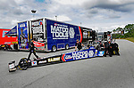 Jan. 17, 2012; Jupiter, FL, USA: Crew members work on the car of NHRA top fuel dragster driver Antron Brown during testing at the PRO Winter Warmup at Palm Beach International Raceway. Mandatory Credit: Mark J. Rebilas-