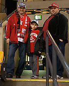 BU rink guys - Paul Magalhaes with son Paul and Roy Estrela - The Northeastern University Huskies defeated the Boston University Terriers 3-2 in the opening round of the 2013 Beanpot tournament on Monday, February 4, 2013, at TD Garden in Boston, Massachusetts.