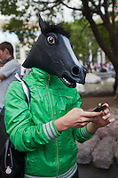 Moscow, Russia, 12/05/2012..A protester wearing a horses head mask tweeting on a mobile phone in Chistiye Prudy, or Clean Ponds, a park in central Moscow were some 200 opposition activists have set up camp.