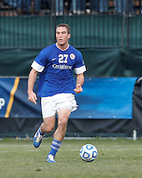 Creighton University defender Brent Kallman (27) looks to pass..NCAA Tournament. Creighton University (blue) defeated University of Connecticut (white), 1-0, at Morrone Stadium at University of Connecticut on December 2, 2012.