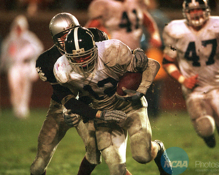 DEC 16 2000: Georgia Southern's Ryan Hadden (12) intercepts Montana's John Edwards pass attempt in the endzone mid-way through the fourth quarter during the Division 1-AA Football Championships held at Max Finley Stadium in Chattanooga, TN. Georgia Southern University went on to defeat Montana 27-25 for the championship title. Ryan McKee/NCAA Photos
