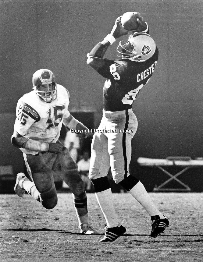 Oakland Raiders tight end Raymond Chester grabs pass in front of San Diego Charger defender.(1978<br />