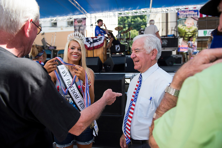 UNITED STATES - JULY 5: Miss West Virginia Freedom Festival Alyx Stover and Rep. Nick Rahall, D-W.Va., present medals to local veterans at the West Virginia Freedom Festival in downtown Logan, W. Va., on July 5, 2014. (Photo By Bill Clark/CQ Roll Call)