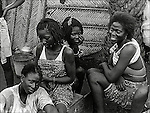 Carrier girls resting at their place in Lome, Togo