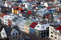 Colorful neighborhood houses in downtown Reykjavik viewed from observation tower of Hallgrimskirkja, Iceland