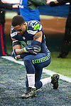 Seattle Seahawks  safety Earl Thomas III (29) takes a knee to pray before their NFC Championship game against the Green Bay Packers at CenturyLink Field in Seattle, Washington on January 18, 2015.  The Seattle Seahawks beat the Green Bay Packers in overtime 28-22 for the NFC Championship Seattle.  ©2015. Photo by Jim Bryant, All Rights Reserved.