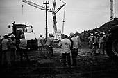 Swiebodzin 06.11.2010 Poland.<br /> Builders devise a plan to mount the head onto the body of Jesus Christ world's largest statue in Swiebodzin, 110 km (68 miles) west of Poznan, western Poland. A project conceived by local Catholic priest Sylwester Zawadzki and paid for by private donations, the statue of Jesus Christ, touted by its builders to be the largest in the world, will measure 33 metres and weigh 440 tonnes.<br /> Photo: Adam Lach / Newsweek Polska / Napo Images<br /> <br /> Robotnicy obmyslaja plan montazu wazacej 5 ton koronowanej glowy, najwiekszego na swiecie posagu Jezusa Chrystusa, ufundowanego przez lokalnego ksiedza w Swiebodzinie, Sylwestra Zawadkiego.<br /> Photo: Adam Lach / Newsweek Polska / Napo Images