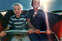 Brothers Andy, 6,and Matt Richardson, 9, take a harrowing trip on the roller coaster on opening day of the California State Fair.  Afterward, Andy, left, said his first-ever ride wasn't the least bit scary. August, 8 1999.