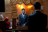 BAGHDAD, IRAQ: Hussein prepares himself moments before his wedding to Hind...On January 22nd, 2012, an IED (Improvised Explosive Devise) detonated near an Iraqi Army base in Fallujah. Hussein Jamil Abdullah, a 28 year-old soldier from Baghdad was nearby when the explosive discharged, knocking him to the ground. Hey lay there for half an hour, his right leg in an jerry-rigged tourniquet made from a headscarf, before he was taken to hospital...Gangrene set in almost immediately and the doctors at Fallujah General Hospital had to amputate his leg. He was then moved to Adnan Hospital, the military medical center, but the care Hussein received was terrible. His bandage wasn'.t changed for two days and fearing that gangrene would set in a second time his family moved him to Kerkh Hospital, which they had to cover the costs themselves, as the army refused to pay...As soon as he was wounded, the Army cut Hussein.s salary in half: from $500 a month to $250, which is less than he can live on. His brother, Ali, has given up his work as a barber to take care of him, and his two other brothers, Abbas and Hassan, now take care of the family...Before he was wounded, Hussein, was to be engaged to his fianc&eacute;e, Hind and he had even bought and furnished a room in preparation. But, after the explosion, Hind.'s father refused to allow them to marry, saying that they can.t do so until Hussein gets a prosthetic leg...In the summer, a selection of photographs were published online and caught the attention of an NGO worker in Baghdad who arranged for Hussein to have a prosthetic leg fitted...Once he had his prosthetic leg, Hussein married Hind.