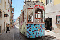 Tram covered in graffiti on a steep narrow street in the old town of Lisbon, Portugal. Picture by Manuel Cohen