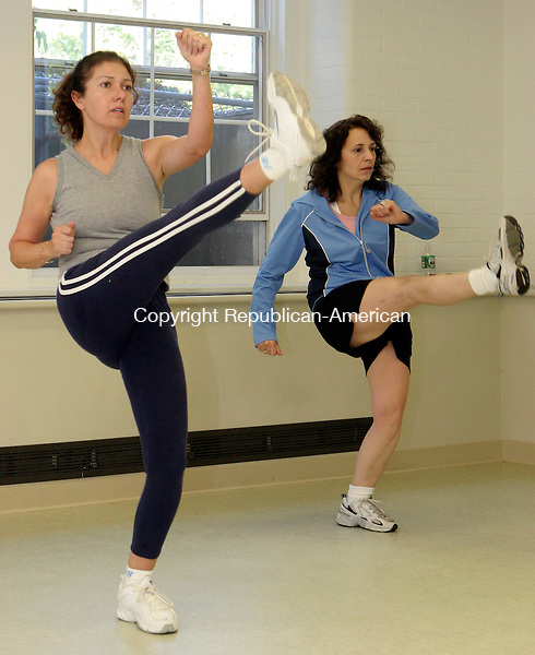 MIDDLEBURY, CT-28September 2006-092806TK05- (left to right) Merci Caldaroni and Beth Rizza work a cardiokickboxing exercise program. Tom Kabelka Republican-American (Merci Caldaroni, Beth Rizza)