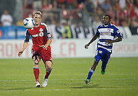 FC Dallas midfielder Marvin Chavez #18 and Toronto FC defender Ty Harden #20 in action during an MLS game between the FC Dallas and the Toronto FC at BMO Field in Toronto on July 20, 2011..FC Dallas won 1-0.