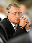 Federal Treasurer Wayne Swan watches as Australian Prime Minister Julia Gillard speaks on the new Queensland flood levy at the National Press Club, Canberra, 27 Jan 2011. Image: Mark Graham