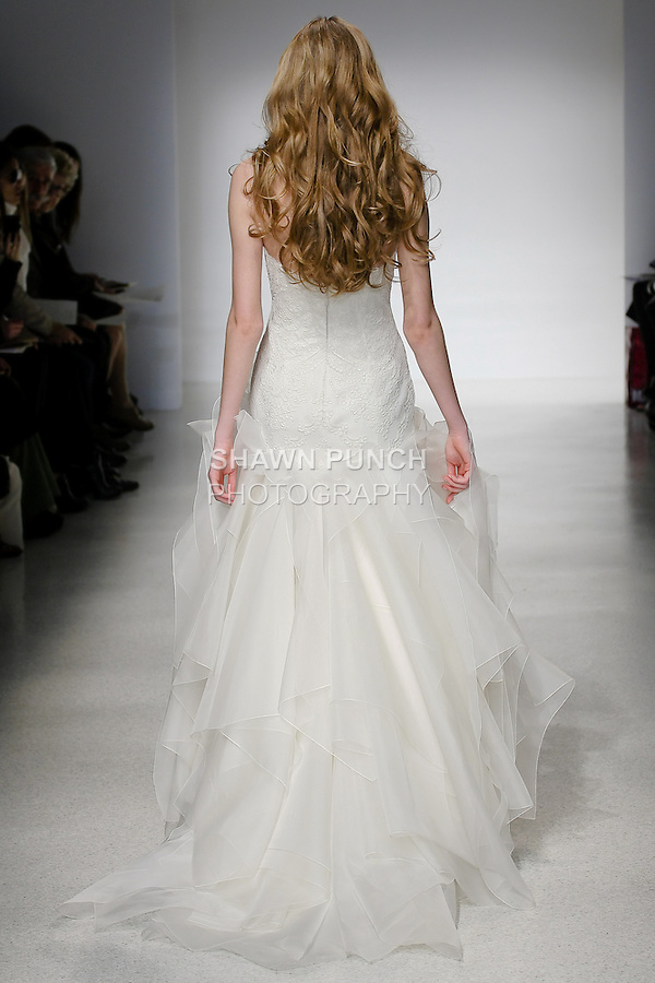 Model walks runway in a Delilah wedding dress by Amsale Aberra, for the Christos Spring 2012 Bridal runway show.