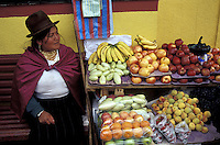 Indigenous woman selling fruit in Cuenca, Ecuador
