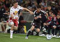 Chris Pontious (13) of D.C. United races away from Jan Gunnar Solli (8) of the New York Red Bulls during an MLS match at RFK Stadium, in Washington D.C. on April 21 2011. Red Bulls won 4-0.