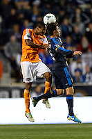 Ricardo Clark (13) of the Houston Dynamo goes up for a header with Michael Farfan (21) of the Philadelphia Union. The Houston Dynamo defeated the Philadelphia Union 1-0 during a Major League Soccer (MLS) match at PPL Park in Chester, PA, on September 14, 2013.