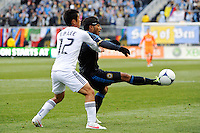 Carlos Valdes (2) of the Philadelphia Union plays the ball under pressure from Young-Pyo Lee (12) of the Vancouver Whitecaps during a Major League Soccer (MLS) match at PPL Park in Chester, PA, on March 31, 2012.