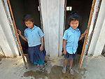 Girls emerge from the latrines at the Shri Pashupati Praja Primary School in the village of Tanglichowk, in the Gorkha District of Nepal. In the aftermath of the April 2015 earthquake that ravaged Nepal, the ACT Alliance helped people in this village with a variety of services, including latrines, emergency shelter, livelihood projects and school construction. School latrines are an important component of keeping girls in school past puberty.