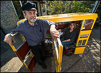 BNPS.co.uk (01202 558833)<br /> Pic: TomWren/BNPS<br /> <br /> Keith Burbidge and his wife Carol.<br /> <br /> Dinky decker...<br /> <br /> A retired bus driver has taken his passion for buses to the next level - by transforming a broken mobility scooter into a quirky mini yellow bus.<br /> <br /> Keith Burbidge, 75, retired as a coach driver last year but missed the mode of public transport so much he decided to make his own miniature version.<br /> <br /> The father-of-two spent just &pound;40 and six months turning a broken scooter he picked up at auction into a working scale-model of a Yellow Bus, the company that operates in his hometown of Bournemouth, Dorset.<br /> <br /> The one-of-a-kind motor is 4ft tall and 6ft long and can only travel at speeds of about 5mph.