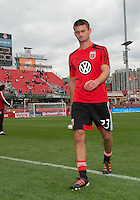 06 October 2012: D.C. United midfielder/defender Perry Kitchen #23 coming off the pitch after warm-up in an MLS game between D.C. United and Toronto FC at BMO Field in Toronto, Ontario..D.C. United won 1-0..