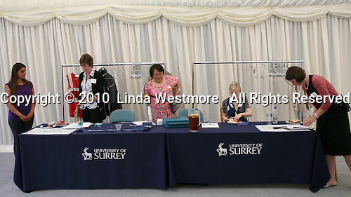 Organisers help run the graduation celebrations, University of Surrey.