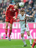 FUSSBALL   1. BUNDESLIGA  SAISON 2011/2012   29. Spieltag FC Bayern Muenchen - FC Augsburg       07.04.2012 Thomas Mueller (li, FC Bayern Muenchen) gegen Paul Verhaegh (FC Augsburg)