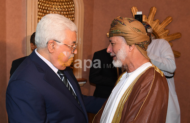 Palestinian President Mahmoud Abbas, meets with Minister of Foreign Affairs of Oman, in the Omani capital Muscat, on May 18, 2017. Photo by Thaer Ganaim