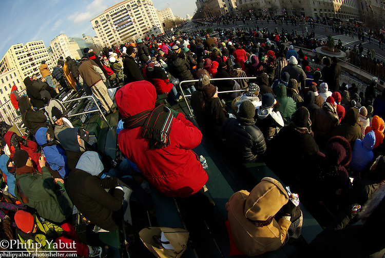 Spectators at Freedom Plaza await the start of President Barack Obama's Inaugural Parade.