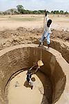 Displaced people and the local host community work together, with help from ACT-Caritas, to build a new well near Deleij. Water is a critical resource in the Darfur region, and making it more available to all contributes to better relations between different social groups.