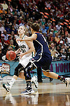 01 APRIL 2012:  Natalie Novosel (21) of the University of Notre Dame drives to the hoop against Caroline Doty (5) of the University of Connecticut during the Division I Women's Final Four Semifinals at the Pepsi Center in Denver, CO.  Notre Dame defeated UCONN 83-75 to advance to the national championship game.  Jamie Schwaberow/NCAA Photos