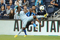 KANSAS CITY, KS - June 1, 2013:<br /> Peterson Joseph (19) midfield Sporting KC arrives too late to block Sanna Nyassi (11) midfield Montreal Impact's cross.<br /> Montreal Impact defeated Sporting Kansas City 2-1 at Sporting Park.