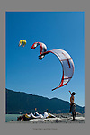 July 21st 2009.  Three kites launched from the Spit.  Boarders help each other by launching and landing each other's kites.  Photo by Gus Curtis.