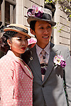 A couple wearing their Sunday best clothes and hats in the Easter Parade in New York City