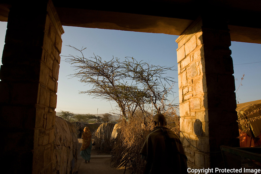 "The porch of State House IDP camp in Hargeysa, Somaliland. The former residence of Britain's colonial governor is now home to 29,000 internally displaced people..According to Ishmail Ibrahim Farah a memeber of the camp's security commitee ""Some people have been here 17 years, some people have grown up here and now they have their own houses ( are married). ..""You can see now how I'm living and the conditions are very bad.  I would prefer to get recognition for my country (the  breakaway republic of Somaliland) rather than have a better life.  Then the next generation, my children, can be part of the international community.  That will happen when god agrees and wants it to happen.  This is the most important thing - getting recognition.  If we get that, we will share with the rest of the world everything, but now we are isolated, it's not just me that thinks this - everyone does - men and women likewise. "" . ...."