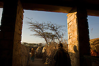 The porch of State House IDP camp in Hargeysa, Somaliland. The former residence of Britain's colonial governor is now home to 29,000 internally displaced people..According to Ishmail Ibrahim Farah a memeber of the camp's security commitee &quot;Some people have been here 17 years, some people have grown up here and now they have their own houses ( are married). ..&quot;You can see now how I'm living and the conditions are very bad.  I would prefer to get recognition for my country (the  breakaway republic of Somaliland) rather than have a better life.  Then the next generation, my children, can be part of the international community.  That will happen when god agrees and wants it to happen.  This is the most important thing - getting recognition.  If we get that, we will share with the rest of the world everything, but now we are isolated, it's not just me that thinks this - everyone does - men and women likewise. &quot; . ....