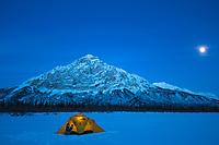 Yellow tent under the moonlight, Brooks Range Mountains, Alaska.